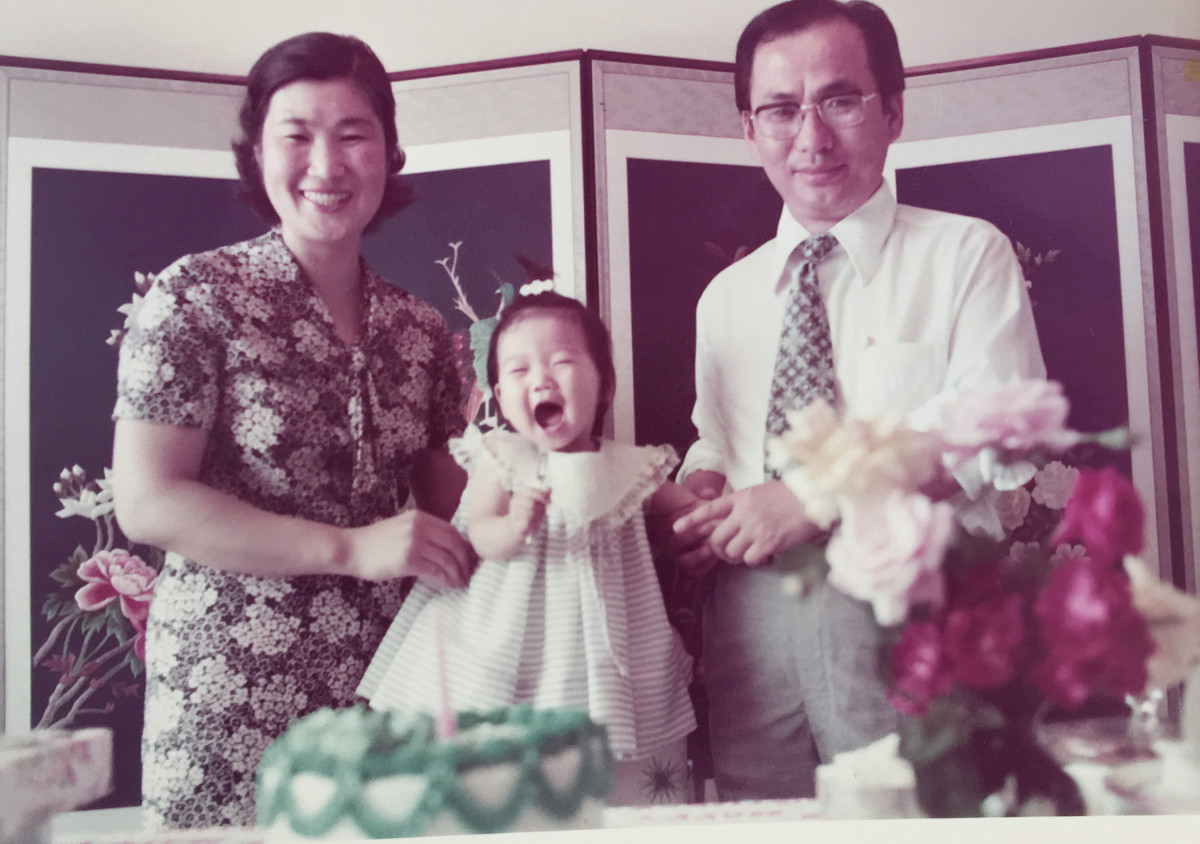Caroll with her parents.