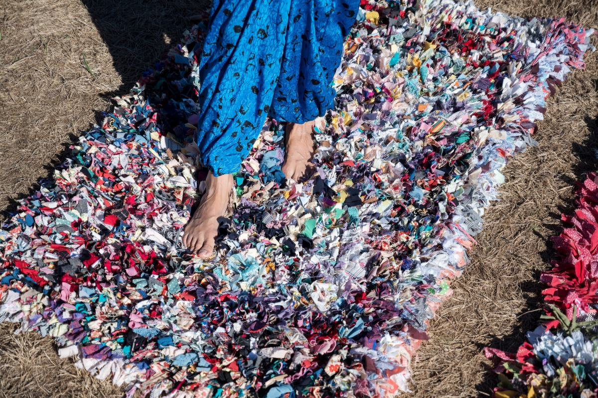 The artist and author Leanne Shapton has been transforming her old clothing, and clothing from friends and neighbors, into bright, deeply textured rugs.Credit...Karsten Moran for The New York Times.